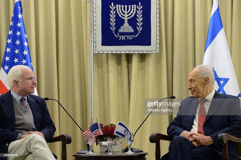 Israeli President Shimon Peres welcomes United States Senator John McCain at the President's residence in Jerusalem Israel on January 4 2014