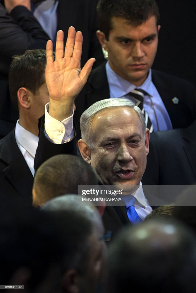 Israeli Prime Minister and chairman of the Likud party Benjamin Netanyahu waves to supporters in Tel Aviv party headquarters early on January 23, 2013 after his Likud-Beitenu list won the Israeli general election. Netanyahu said it was necessary to form the 'broadest possible government' after his Likud-Beitenu list won a narrow election victory, with the centrist Yesh Atid in second place.