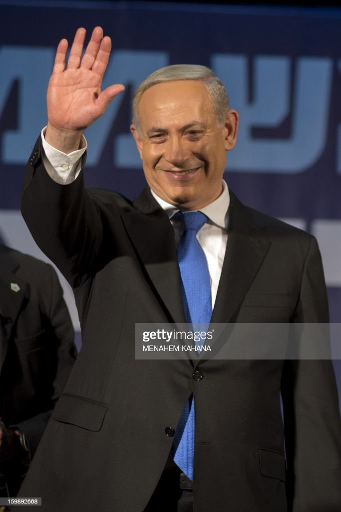 Israeli Prime Minister and chairman of the Likud party Benjamin Netanyahu waves to supporters at the party headquarters in Tel Aviv early on January 23, 2013 after his Likud-Beitenu list won the Israeli general election. Netanyahu said it was necessary to form the 'broadest possible government' after his Likud-Beitenu list won a narrow election victory, with the centrist Yesh Atid in second place.