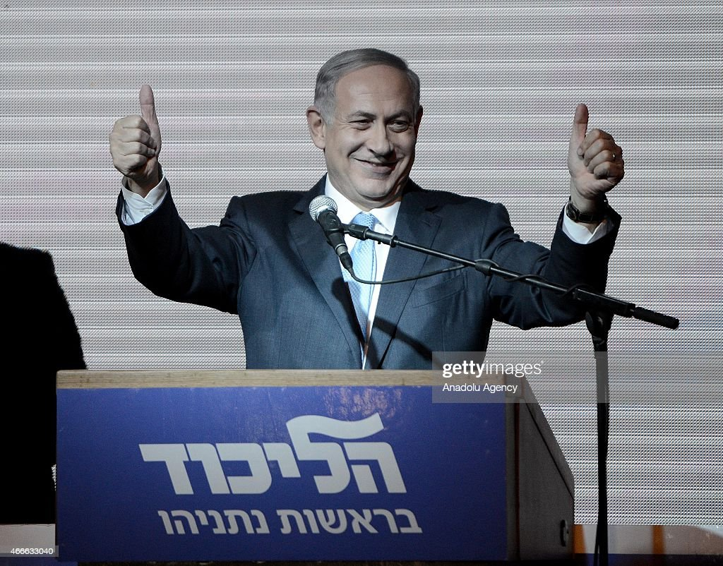Israeli Prime Minister and the leader of the Likud Party <a gi-track='captionPersonalityLinkClicked' href=/galleries/search?phrase=Benjamin+Netanyahu&family=editorial&specificpeople=118594 ng-click='$event.stopPropagation()'>Benjamin Netanyahu</a> greets supporters at the party's election headquarters after the first results of the Israeli general election on March 18, 2015 in Tel Aviv, Israel.