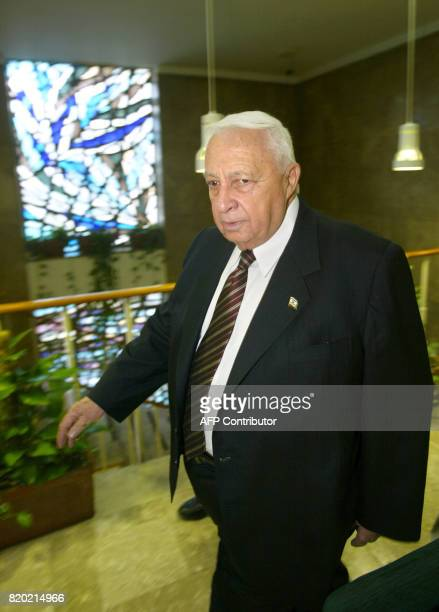 Israeli Prime Minister Ariel Sharon arrives for the weekly cabinet meeting in Jerusalem 26 October 2003 Israel cabinet briefed by chief of staff...