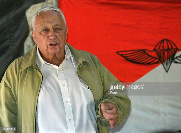 Israeli Prime Minister Ariel Sharon gestures as he speaks to officers and soldiers November 14 2002 overlooking the Palestinian town of Nablus on the...