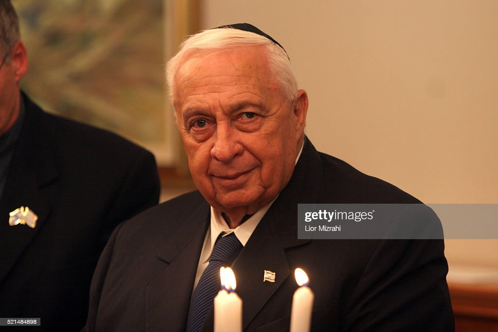 Israeli Prime minister Ariel Sharon is seen as he takes part in the lighting of the second Hanukkah candle at his Jerusalem office Monday Dec 26 2005...