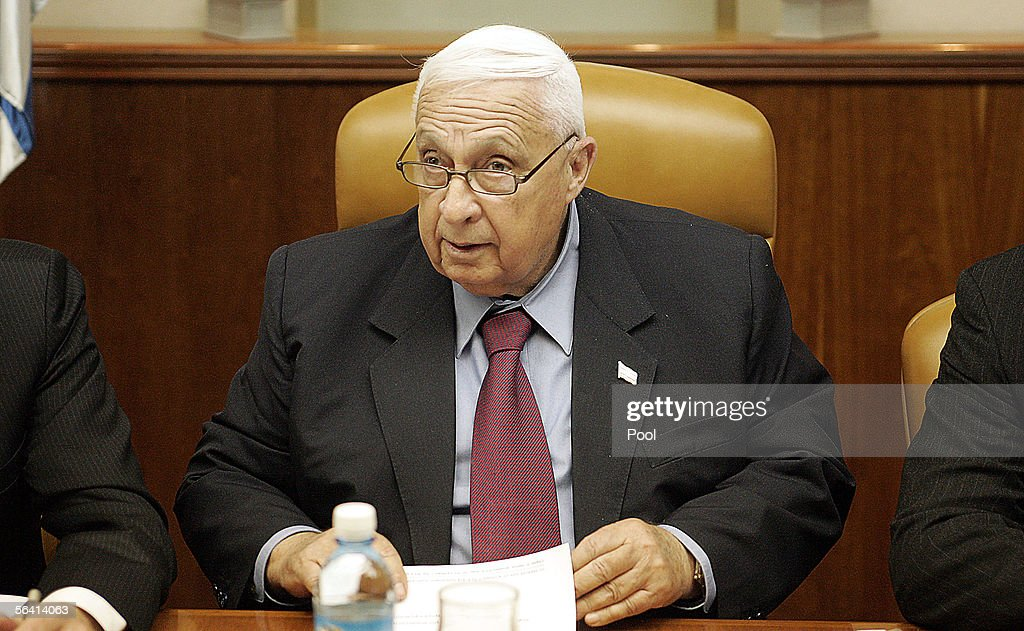 Israeli Prime Minister <a gi-track='captionPersonalityLinkClicked' href=/galleries/search?phrase=Ariel+Sharon&family=editorial&specificpeople=156426 ng-click='$event.stopPropagation()'>Ariel Sharon</a> opens the weekly cabinet meeting on December 11, 2005 at his Jerusalem offices in Israel. Israel's Defence Minister Shaul Mofaz has dropped out of the contest to become leader of Likud and defected to Sharon's new Kadima party, army radio reported Sunday.