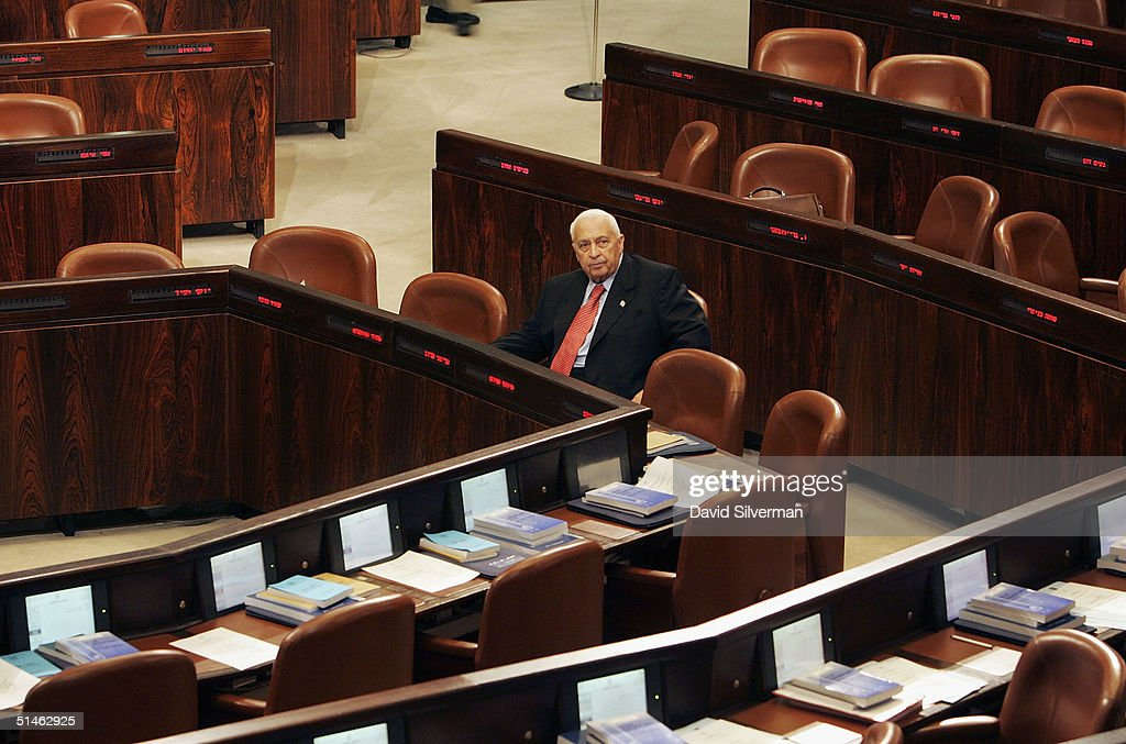 Israeli Prime Minister <a gi-track='captionPersonalityLinkClicked' href=/galleries/search?phrase=Ariel+Sharon&family=editorial&specificpeople=156426 ng-click='$event.stopPropagation()'>Ariel Sharon</a> sits alone at the cabinet table at the start of the opening of the winter session of Israel's Knesset parliament, October 11, 2004 in Jerusalem, Israel. Sharon will face an uphill battle to get his Gaza disengagement legislation approved by the Knesset in the coming months.