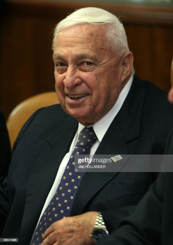 Israeli prime Minister <a gi-track='captionPersonalityLinkClicked' href=/galleries/search?phrase=Ariel+Sharon&family=editorial&specificpeople=156426 ng-click='$event.stopPropagation()'>Ariel Sharon</a> smiles as he chairs the final cabinet meeting of his coalition government, 20 November 2005 in his Jerusalem offices. It is expected that the Knesset (Parliament) will dissolve itself this week, paving the way for early general elections, probably in March 2006. It is not clear if Sharon will remain inside his Likud party or form a new political party. AFP PHOTO/POOL/JIM HOLLADER