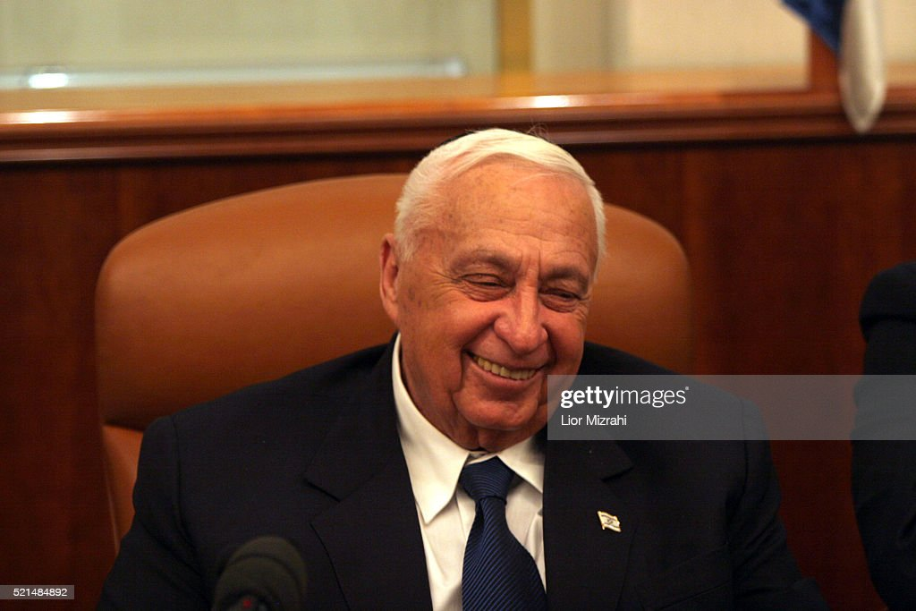Israeli Prime minister <a gi-track='captionPersonalityLinkClicked' href=/galleries/search?phrase=Ariel+Sharon&family=editorial&specificpeople=156426 ng-click='$event.stopPropagation()'>Ariel Sharon</a> smiles as he takes part in the lighting of the second Hanukkah candle, at his Jerusalem office Monday Dec. 26, 2005. Prime Minister <a gi-track='captionPersonalityLinkClicked' href=/galleries/search?phrase=Ariel+Sharon&family=editorial&specificpeople=156426 ng-click='$event.stopPropagation()'>Ariel Sharon</a> was unable to make decisions and had difficulty speaking when he was rushed to the hospital after a stroke last Sunday night, his doctors revealed on Monday.