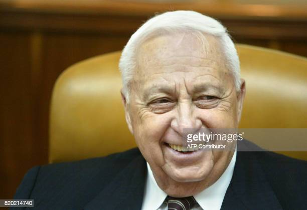 Israeli Prime Minister Ariel Sharon smiles during the weekly cabinet meeting in Jerusalem 26 October 2003 Israel cabinet briefed by chief of staff...