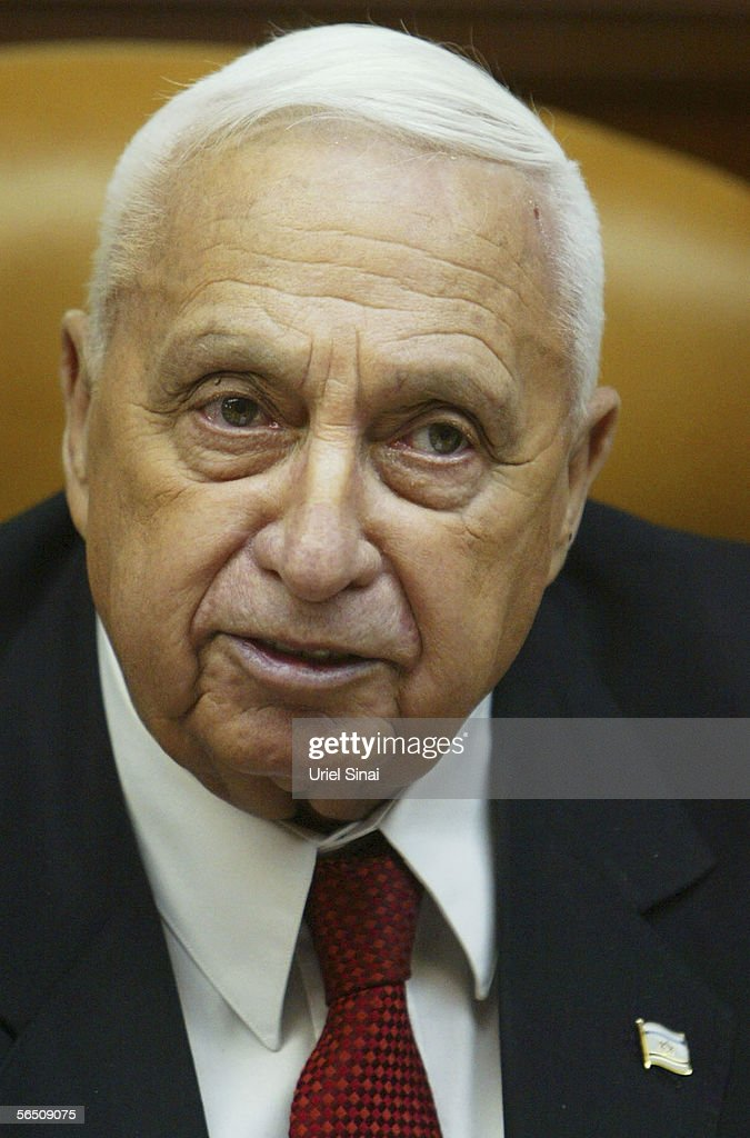 Israeli Prime Minister <a gi-track='captionPersonalityLinkClicked' href=/galleries/search?phrase=Ariel+Sharon&family=editorial&specificpeople=156426 ng-click='$event.stopPropagation()'>Ariel Sharon</a> speaks at the start of the weekly cabinet meeting on January 01, 2006 in his offices in Jerusalem. Sharon is to undergo a minor heart operation to close a small hole which doctors found after he had a minor stroke. The procedure will be carried out in the next few weeks.