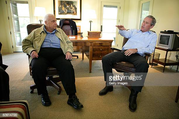 Israeli Prime Minister Ariel Sharon talks with President George W Bush at Bush's ranch April 11 2005 in Crawford Texas The two were meeting to...