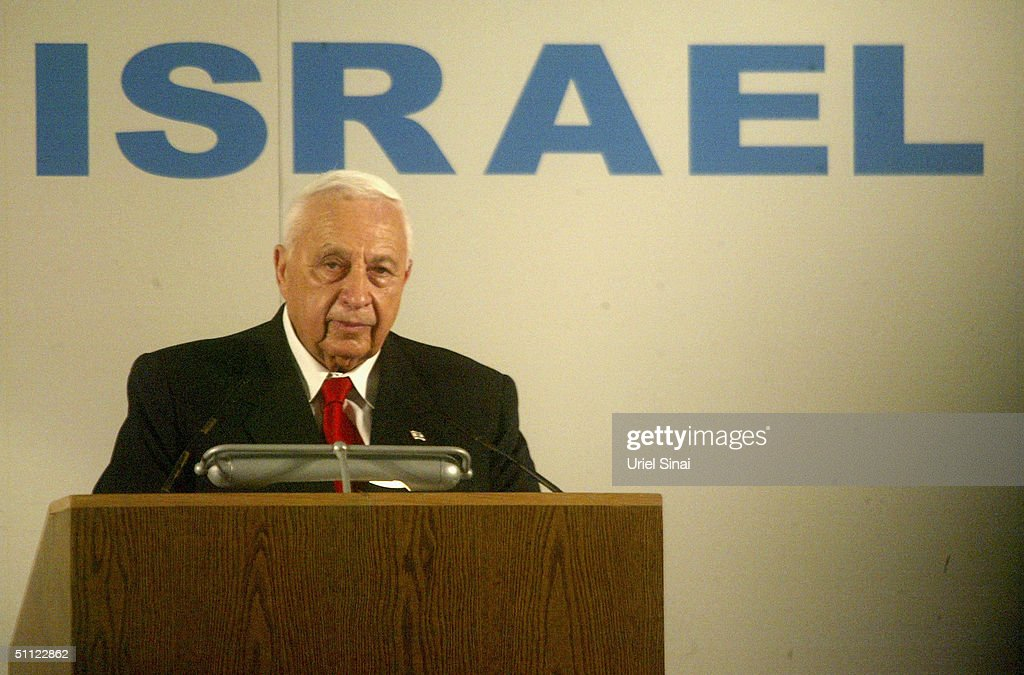 Israeli Prime Minister Ariel Sharon welcomes French Jewish immigrants July 28 2004 on their arrival at Israel's Ben Gurion Airport near Tel Aviv The...