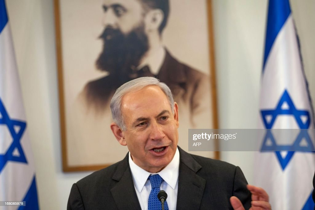 Israeli Prime Minister Benjamin Netanyahu addresses the weekly cabinet meeting at the Herzl Museum in Jerusalem on May 5, 2013. Israel carried out a pre-dawn air strike near Damascus, targeting Iranian missiles destined for Lebanon's Hezbollah in the second such raid on Syrian soil in three days, a senior Israeli source said. AFP PHOTO/POOL/EMIL SALMAN