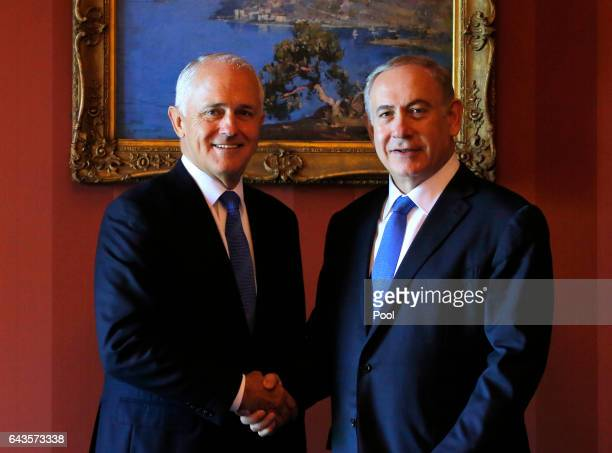 Israeli Prime Minister Benjamin Netanyahu and Australian Prime Minister Malcolm Turnbull shake hands before their bilateral meeting at Admiralty...