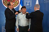 Israeli Prime Minister Benjamin Netanyahu and Defence Minister Moshe Yaalon swear Lieutenant General Gadi Eisenkot in as the country's new chief of...