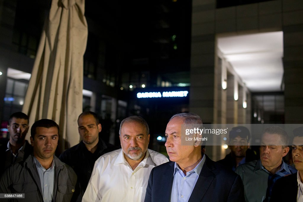 Israeli Prime Minister <a gi-track='captionPersonalityLinkClicked' href=/galleries/search?phrase=Benjamin+Netanyahu&family=editorial&specificpeople=118594 ng-click='$event.stopPropagation()'>Benjamin Netanyahu</a> (R) and Defence Minister Avigdor Liberman speak to the press at the scene of a shooting outside Max Brenner restaurant in Sarona Market on June 8, 2016 in Tel Aviv, Israel. According to police reports, four Israelis were killed and several others wounded when two Palestinian gunmen open fire at the food and retail complex in central Tel Aviv.