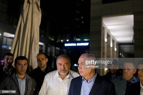 Israeli Prime Minister Benjamin Netanyahu and Defence Minister Avigdor Liberman speak to the press at the scene of a shooting outside Max Brenner...