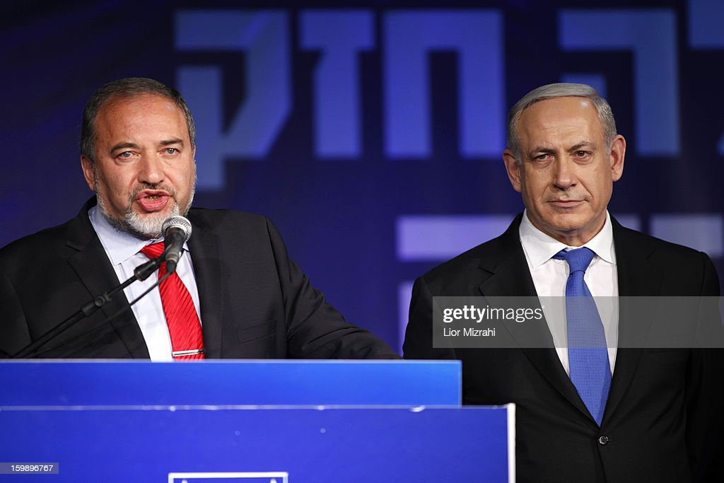 Israeli Prime Minister <a gi-track='captionPersonalityLinkClicked' href=/galleries/search?phrase=Benjamin+Netanyahu&family=editorial&specificpeople=118594 ng-click='$event.stopPropagation()'>Benjamin Netanyahu</a> and Former Israel Minister for Foreign Affairs Avigdor Liberman at his election campaign headquarters on Janurary 23, 2013 in Tel Aviv, Israel. Netanyahu was re-elected for a third term and will return to office, according to exit polls. Israel had the highest turnout of voters since 1999.