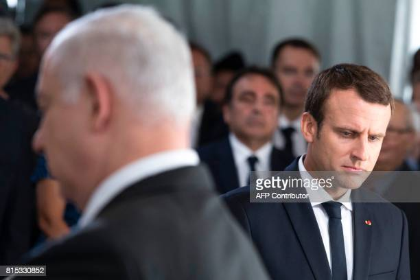 Israeli Prime Minister Benjamin Netanyahu and French President Emmanuel Macron attend a ceremony commemorating the 75th anniversary of the Vel d'Hiv...
