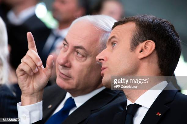 Israeli Prime Minister Benjamin Netanyahu and French President Emmanuel Macron speak during a ceremony commemorating the 75th anniversary of the Vel...
