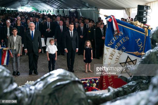 Israeli Prime Minister Benjamin Netanyahu and French President Emmanuel Macron pay their respects after laying wreaths during a ceremony...