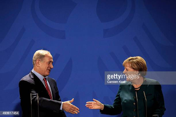 Israeli Prime Minister Benjamin Netanyahu and German Chancellor Angela Merkel attend a press conference at the Chancellery on October 21 2015 in...
