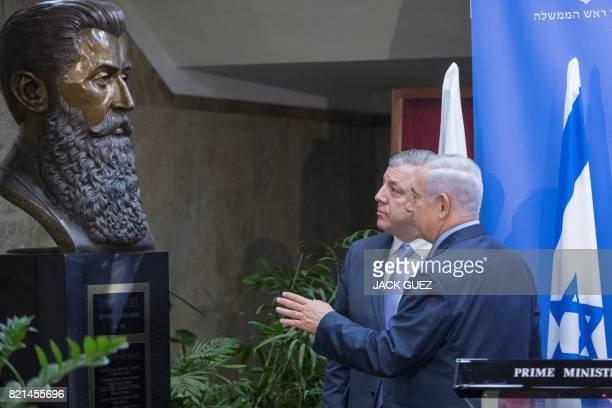 Israeli Prime Minister Benjamin Netanyahu and his Georgian counterpart Giorgi Kvirikashvili look at a bust of Theodor Herzl during a press conference...