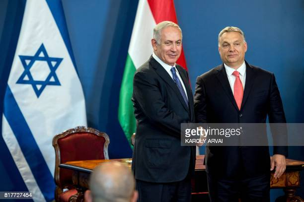 Israeli Prime Minister Benjamin Netanyahu and his Hungarian counterpart Viktor Orban shake hands as they give a joint press conference at the...