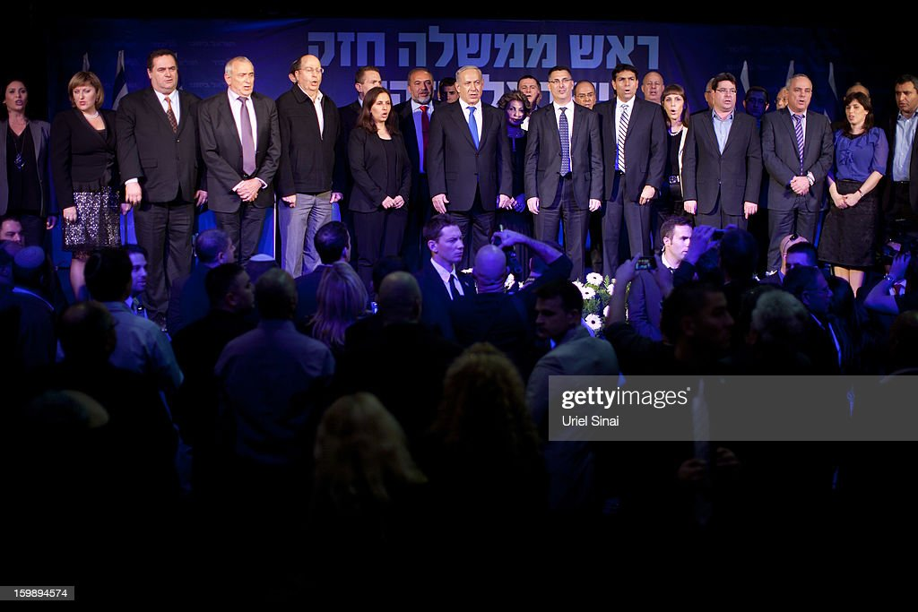 Israeli Prime Minister Benjamin Netanyahu and his party members stand on stage at his election campaign headquarters on Janurary 23, 2013 in Tel Aviv, Israel. Exit polls suggested that current Prime Minister Benjamin Netanyahu will return to office, although he performed worse than expected.