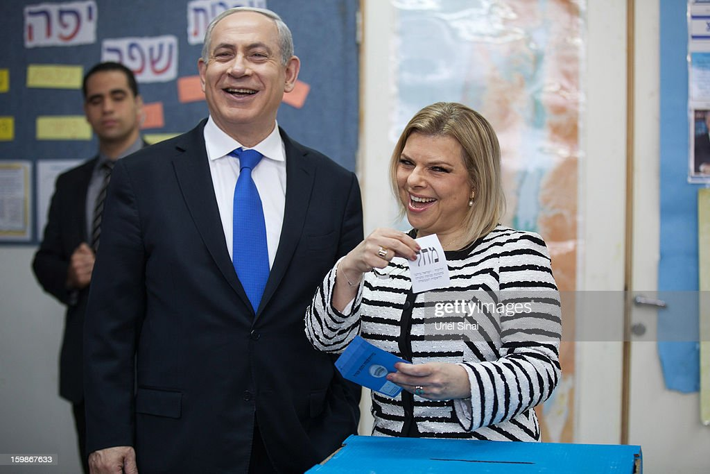 Israeli Prime Minister Benjamin Netanyahu and his wife <a gi-track='captionPersonalityLinkClicked' href=/galleries/search?phrase=Sara+Netanyahu&family=editorial&specificpeople=1061079 ng-click='$event.stopPropagation()'>Sara Netanyahu</a> cast their ballot at a polling station on election day on January 22, 2013 in Jerusalem, Israel. Israel's general election voting has begun today as polls show Netanyahu is expected to return to office with a narrow majority.
