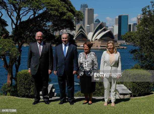 Israeli Prime Minister Benjamin Netanyahu and his wife Sara pose in front of the Sydney Opera House with Australia's GovernorGeneral Peter Cosgrove...