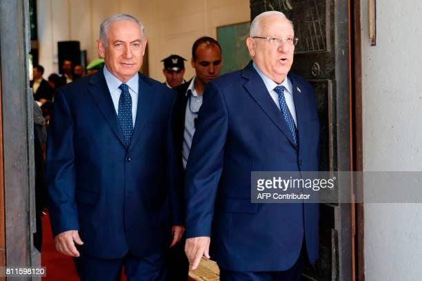 Israeli Prime Minister Benjamin Netanyahu and Israeli President Reuven Rivlin arrive at a welcome ceremony for Rwanda's president at the presidential...