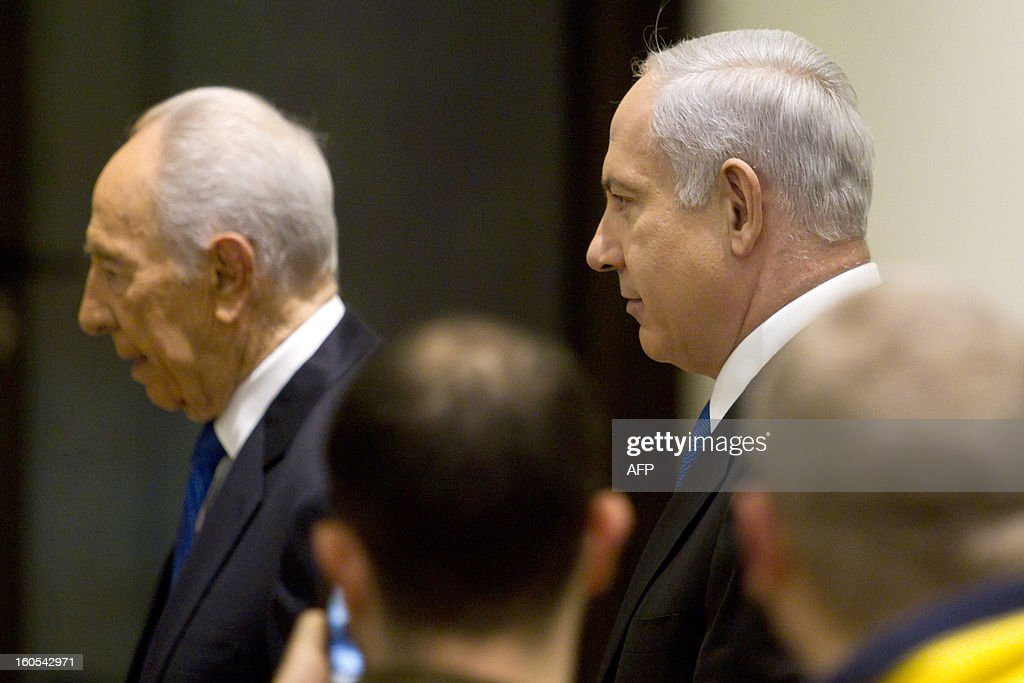 Israeli Prime Minister Benjamin Netanyahu (R) and Israeli President Simon Peres walk into a hall for a brief ceremony in the president' Jerusalem residence, on February 2, 2013, after Peres tasked Netanyahu with forming a new government after two days of intense talks with the parties recently elected to the new parliament.