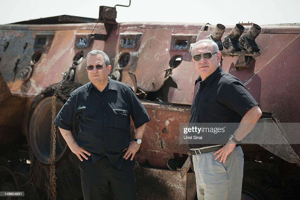 Israeli Prime Minister Benjamin Netanyahu (R) and Israel's defense Minister Ehud Barak stand next to the wreckage of an Egyptian military vehicle after militants drove it through a security fence into Israel from Egypt, at an Israeli military base on the Israeli side of the border with Egypt on August 6, 2012 in Kerem Shalom, Israel. The seizure of two military vehicles by Islamist miltants came after an armed attack on a police station in North Sinai which left at least 16 soldiers dead. An Israeli aircraft destroyed one of the vehicles (pictured here) killing four gunmen onboard.