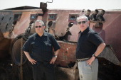Israeli Prime Minister Benjamin Netanyahu and Israel's defense Minister Ehud Barak stand next to the wreckage of an Egyptian military vehicle after...