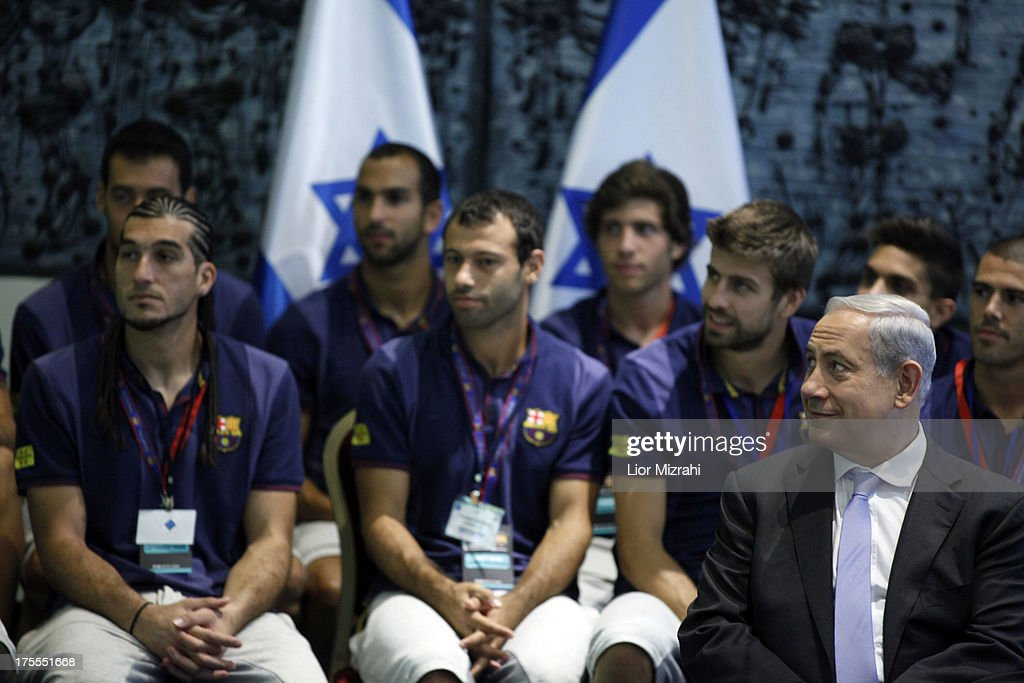 Israeli Prime Minister <a gi-track='captionPersonalityLinkClicked' href=/galleries/search?phrase=Benjamin+Netanyahu&family=editorial&specificpeople=118594 ng-click='$event.stopPropagation()'>Benjamin Netanyahu</a> and Members of FC Barcelona look on during a ceremony at the President house on August 4, 2013 in Jerusalem, Israel. Members of the FC Barcelona squad have travelled to the Middle East to visit Israel and the West Bank as part of a two-day 'peace tour'.