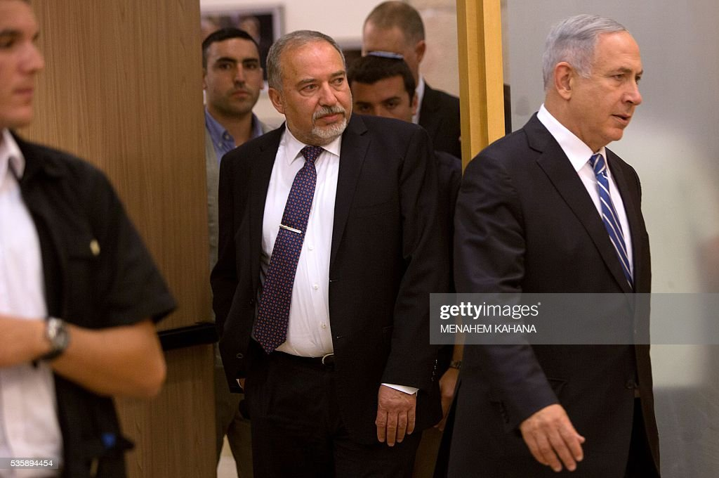 Israeli Prime Minister Benjamin Netanyahu (R) and new Defence Minister Avigdor Lieberman (C) arrive for a joint press conference at the Knesset, the Israeli parliament, in Jerusalem on May 30, 2016. The Israeli parliament approved Lieberman as the country's new defence minister hours after Netanyahu's cabinet endorsed him. Lieberman, who has pledged harsh measures against Palestinian 'terrorists', was approved by 55 members of the 120-seat Knesset while 43 voted against, one abstained and the others were absent. KAHANA