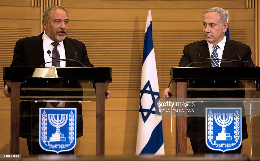 Israeli Prime Minister Benjamin Netanyahu (R) and new Defence Minister Avigdor Lieberman (L) give a joint press conference at the Knesset, the Israeli parliament, in Jerusalem on May 30, 2016. The Israeli parliament approved Lieberman as the country's new defence minister hours after Netanyahu's cabinet endorsed him. Lieberman, who has pledged harsh measures against Palestinian 'terrorists', was approved by 55 members of the 120-seat Knesset while 43 voted against, one abstained and the others were absent. KAHANA