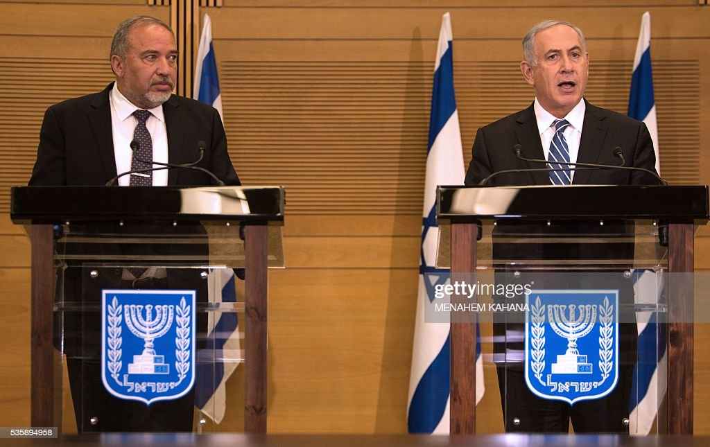 Israeli Prime Minister Benjamin Netanyahu (R) and new Defence Minister Avigdor Lieberman (L) give a joint press conference at the Knesset, the Israeli parliament, in Jerusalem on May 30, 2016. Ultra-nationalist Avigdor Lieberman was sworn in as Israel's new defence minister after winning support in the cabinet and in parliament, ending weeks of political intrigue and outrage. Prime Minister Benjamin Netanyahu's cabinet voted to expand his coalition and appoint Lieberman, before the 120-seat Knesset approved him by a vote of 55-43. KAHANA