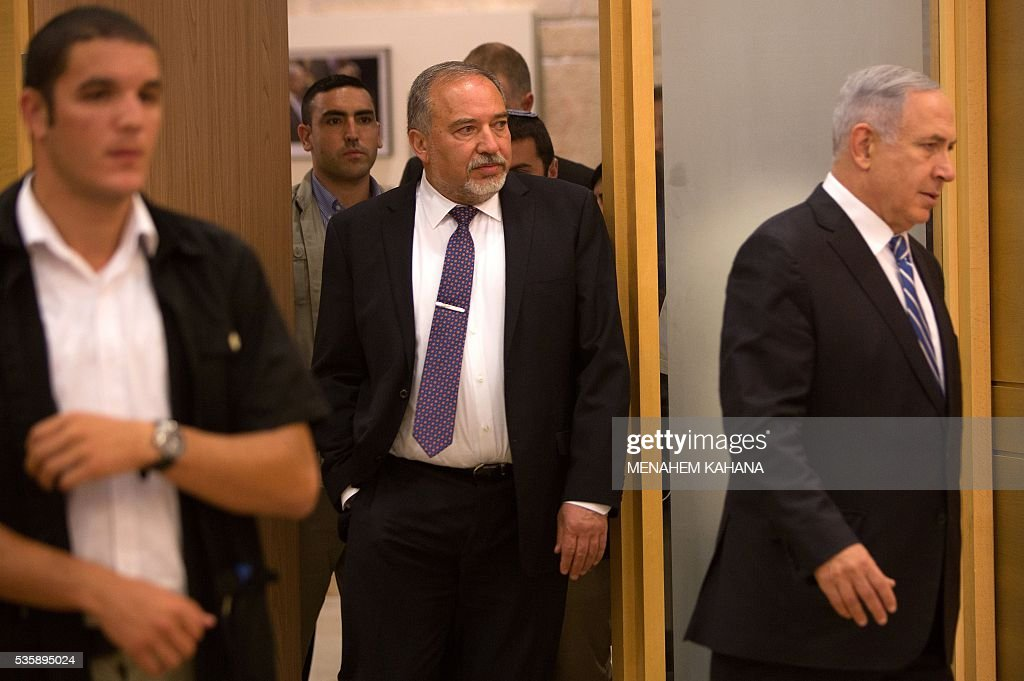 Israeli Prime Minister Benjamin Netanyahu (R) and new Defence Minister Avigdor Lieberman (C) arrive for a joint press conference at the Knesset, the Israeli parliament, in Jerusalem on May 30, 2016. Lieberman was sworn in as Israel's new defence minister after winning support in the cabinet and in parliament, ending weeks of political intrigue and outrage. Netanyahu's cabinet voted to expand his coalition and appoint Lieberman, before the 120-seat Knesset approved him by a vote of 55-43. KAHANA