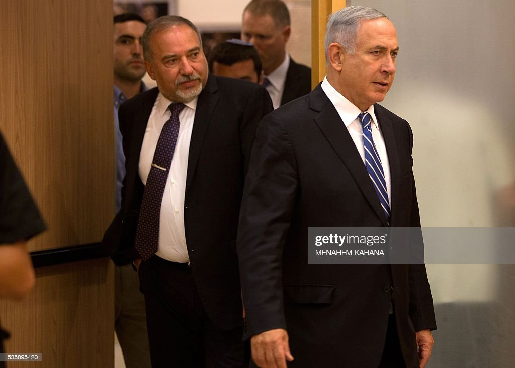 Israeli Prime Minister Benjamin Netanyahu (R) and new Defence Minister Avigdor Lieberman (L) arrive for a joint press conference at the Knesset, the Israeli parliament, in Jerusalem on May 30, 2016. The Israeli parliament approved Lieberman as the country's new defence minister hours after Netanyahu's cabinet endorsed him. Lieberman, who has pledged harsh measures against Palestinian 'terrorists', was approved by 55 members of the 120-seat Knesset while 43 voted against, one abstained and the others were absent. KAHANA