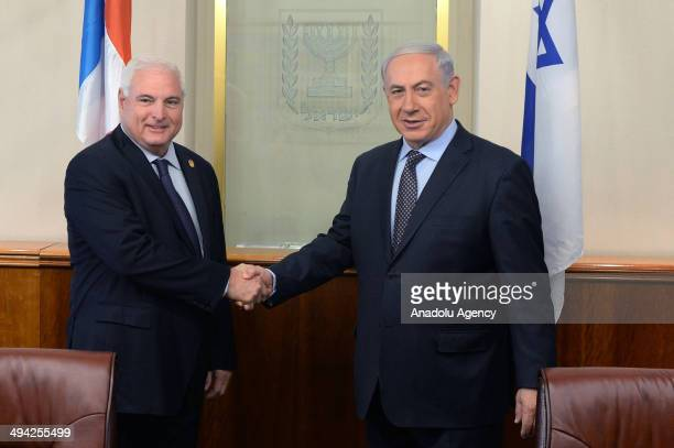 Israeli Prime Minister Benjamin Netanyahu and President of Panama Ricardo Martinelli shake hands during their meeting at Prime Ministry's office in...