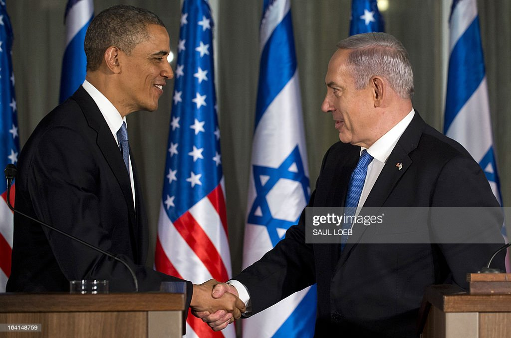 Israeli Prime Minister Benjamin Netanyahu (R) and US President Barack Obama shake hands during a joint press conference at the Prime Minister's Residence in Jerusalem, March 20, 2013, on the first day of Obama's three day trip to Israel. AFP PHOTO / Saul LOEB
