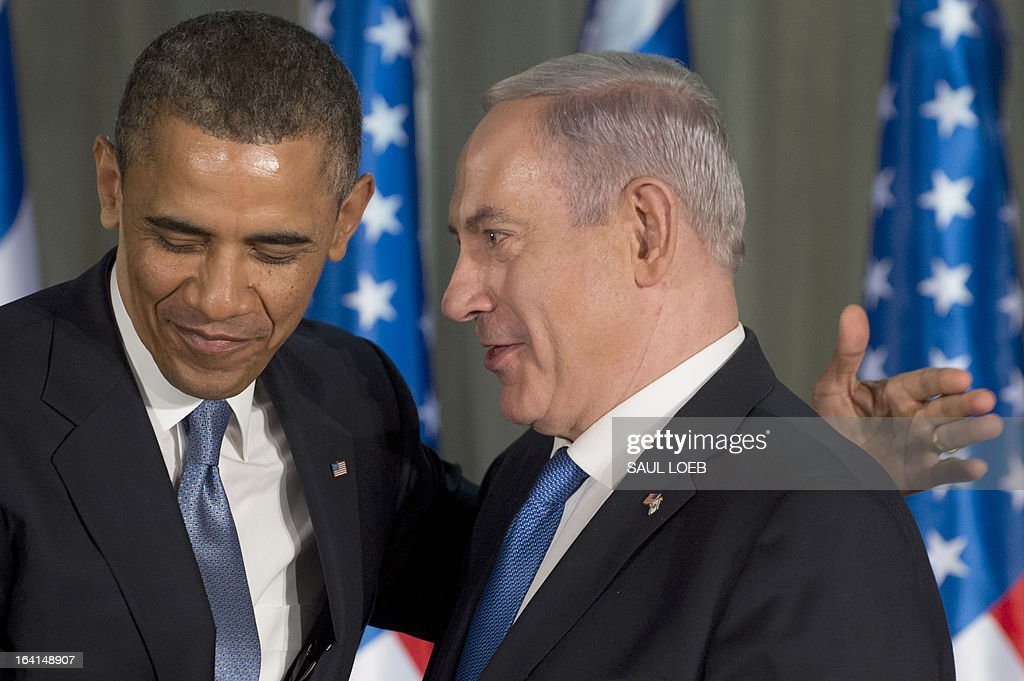 Israeli Prime Minister Benjamin Netanyahu and US President Barack Obama greet each other during a joint press conference at the Prime Minister's Residence in Jerusalem, on March 20, 2013, on the first day of Obama's three day trip to Israel and the Palestinian Territories. AFP PHOTO / Saul LOEB