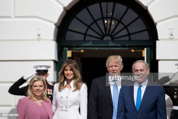 Israeli Prime Minister Benjamin Netanyahu and US President Donald Trump stand with their wives first lady Melania Trump and Sara Netanyahu as they...