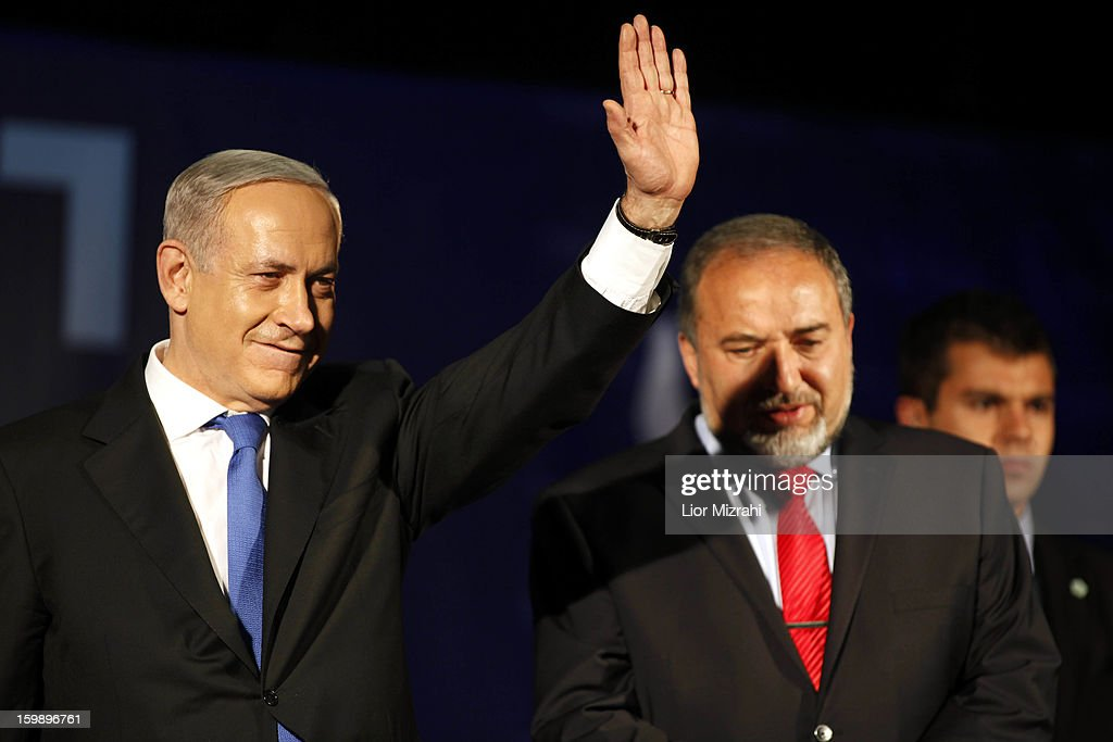 Israeli Prime Minister Benjamin Netanyahu and waves to supporters with Former Israel Minister for Foreign Affairs Avigdor Liberman at his election campaign headquarters on Janurary 23, 2013 in Tel Aviv, Israel. Netanyahu was re-elected for a third term and will return to office, according to exit polls. Israel had the highest turnout of voters since 1999.