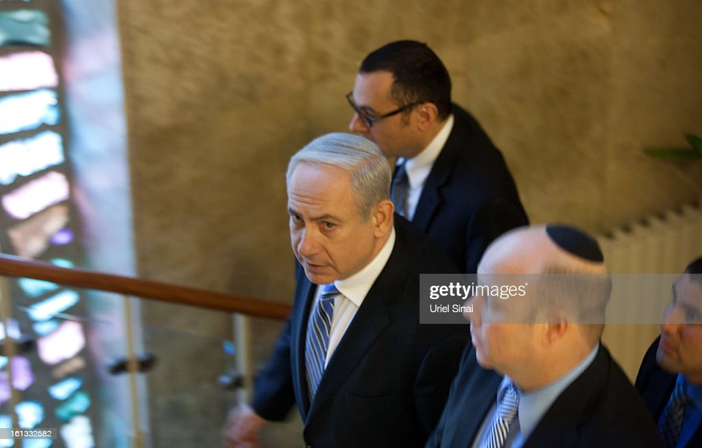 Israeli Prime Minister <a gi-track='captionPersonalityLinkClicked' href=/galleries/search?phrase=Benjamin+Netanyahu&family=editorial&specificpeople=118594 ng-click='$event.stopPropagation()'>Benjamin Netanyahu</a> arives for the weekly cabinet meeting in his office on February 10, 2013 in Jerusalem, Israel. The topics of debate which Netanyahu will hold with US President Obama were addressed during the weekly meeting. Obama is due to visit March 20.