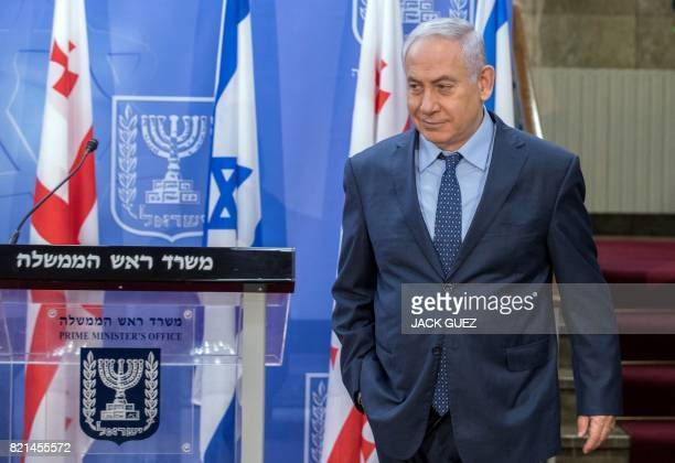 Israeli Prime Minister Benjamin Netanyahu arrives for a press conference with his Georgian counterpart at his office in Jerusalem on July 24 2017...