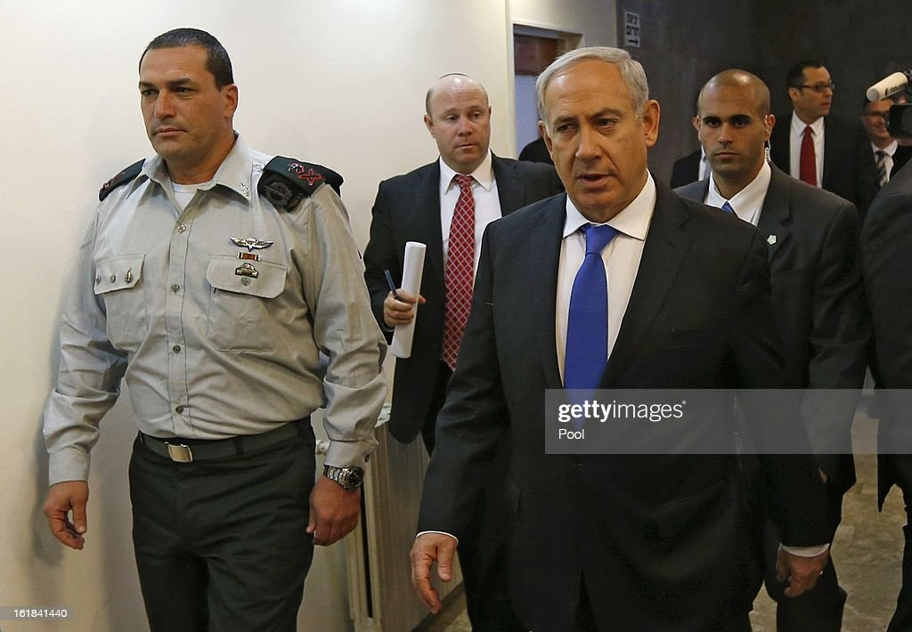 Israeli Prime Minister <a gi-track='captionPersonalityLinkClicked' href=/galleries/search?phrase=Benjamin+Netanyahu&family=editorial&specificpeople=118594 ng-click='$event.stopPropagation()'>Benjamin Netanyahu</a> (R) arrives for the weekly cabinet meeting on February 17, 2013 in Jerusalem, Israel. Netanyahu made a statement reaffirming his trust in the Israeli security forces and asking that they be spared undue media attention, a response made in relation to the 'Prisoner X' affair in which the suicide in Ayalon Prison of an Australin immigrant to Israel is speculated to have been espionage related and with Mossad involvement.