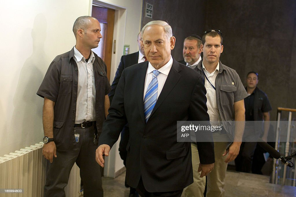 Israeli Prime Minister Benjamin Netanyahu arrives to attend the weekly cabinet meeting at his Jerusalem office on October 27, 2013.
