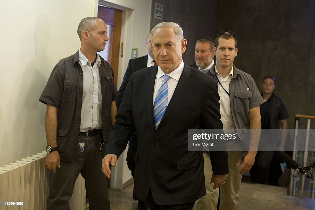 Israeli Prime Minister <a gi-track='captionPersonalityLinkClicked' href=/galleries/search?phrase=Benjamin+Netanyahu&family=editorial&specificpeople=118594 ng-click='$event.stopPropagation()'>Benjamin Netanyahu</a> arrives to chair the weekly cabinet meeting in his Jerusalem office, on October 27, 2013 in Jerusalem, Issrael.